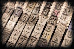Закройте вверх детальной текстуры избитой фразы, альфы, номеров Стоковое Фото