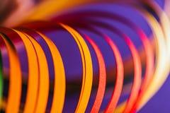 Закройте вверх желтых и красных quilling бумажных кривых Стоковое Изображение RF