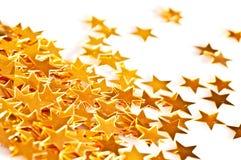 Закройте вверх золотых звезд Стоковые Изображения