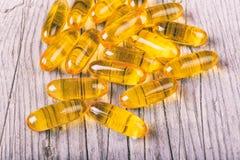 Закройте вверх капсул масла рыб omega-3 тучных Стоковая Фотография