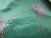 Закройте вверх картины на винтажной ткани Стоковое Изображение