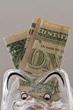 Закройте вверх копилки вполне с долларами США Стоковые Изображения RF