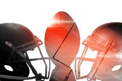 Закройте вверх коричневого американского футбола на тройнике шлемами спорт Стоковое Фото