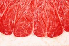 Закройте вверх красного грейпфрута изолированного на белизне Стоковое фото RF