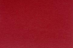 Закройте вверх красных бумажных текстуры или предпосылки Стоковые Изображения