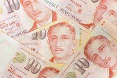 Закройте вверх кучи денег и предпосылки Сингапура стоковая фотография