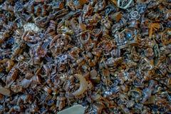 Закройте вверх малых бронзовых ремесел различных диаграмм для получите везение в Pokhara стоковое фото