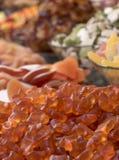 Закройте вверх мягких оранжевых конфет плодоовощ Конфеты сложены вверх Стоковое Изображение
