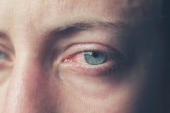 Закройте вверх на плача глазах женщины Стоковое фото RF