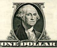 Закройте вверх одного доллара изолированного на белой предпосылке Стоковые Фотографии RF
