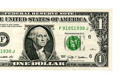 Закройте вверх одного доллара изолированного на белой предпосылке Стоковые Изображения RF