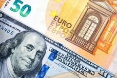 Закройте вверх по 50 100 банкнот доллара предпосылкам евро и стоковое изображение