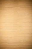 Закройте вверх по бежевой коричневой бамбуковой striped циновкой картине текстуры предпосылки Стоковая Фотография