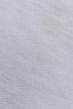 Закройте вверх по белой текстуре ткани Справочная информация Стоковая Фотография RF