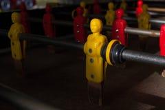 Закройте вверх по взгляду желтого игрока на игрушке футбола Стоковая Фотография RF