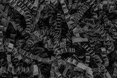 Закройте вверх по взгляду поверхности предпосылки бумажных прокладок коробки черноты шредера пука курчавой стоковое фото