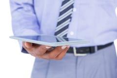 Закройте вверх по взгляду бизнесмена используя планшет Стоковое Изображение RF