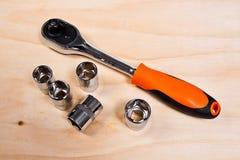 Закройте вверх по взгляду комплекта инструмента ремонта на деревянной предпосылке Стоковые Фото