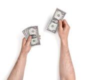 Закройте вверх по взгляду рук человека подсчитывая долларовые банкноты, изолированному на белой предпосылке Стоковая Фотография