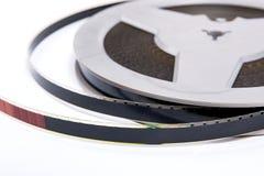 Закройте вверх по взгляду старой прокладки фильма cine изолированной на белом backgroun Стоковая Фотография RF