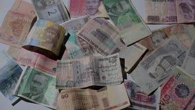 Закройте вверх по двигать различного счета monet бумаги страны акции видеоматериалы