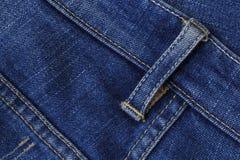 Закройте вверх по голубым джинсам Стоковая Фотография