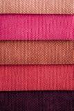 Закройте вверх по детали Multi образцов текстуры ткани цвета Стоковые Фото