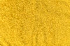 Закройте вверх по желтой текстуре ватки Справочная информация Стоковое фото RF