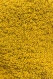 Закройте вверх по желтой текстуре ватки Справочная информация Стоковые Изображения