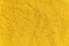 Закройте вверх по желтой текстуре ватки Справочная информация Стоковая Фотография