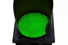 Закройте вверх по знаку движения зеленого света идущему Стоковое Фото