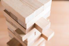 Закройте вверх по игре блоков деревянной на предпосылке деревянного стола Стоковая Фотография RF