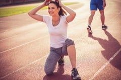 Закройте вверх по изображению усмехаясь молодой женщины спорта Стоковое Фото