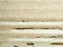 Закройте вверх по картону коричневого цвета царапины рифлёному, абстрактному backgroun Стоковые Фото