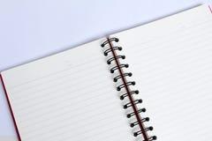 Закройте вверх по книге на белой таблице Стоковые Изображения RF