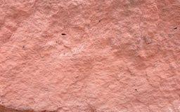 Закройте вверх по красной поверхностной каменной предпосылке, обоям Стоковые Фото