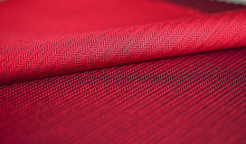 Закройте вверх по красному костюму ткани Стоковые Изображения RF