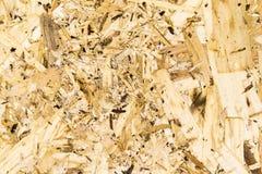 Закройте вверх по поверхности предпосылки прессованной древесины брея плиту - макулатурный картон стоковое фото rf