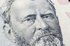Закройте вверх по портрету взгляда Ulysses s Grant на одной долларовой банкноте 50 Предпосылка денег долларовая банкнота 50 с Uly стоковое фото