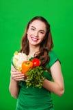 Закройте вверх по портрету молодой женщины с овощами Стоковые Изображения