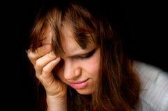 Закройте вверх по портрету плача женщины изолированной на черноте Стоковое фото RF