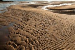 Закройте вверх по предпосылке песка пляжа взгляда Стоковое Изображение