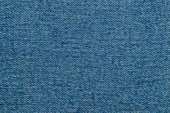 Закройте вверх по предпосылке текстуры ткани джинсовой ткани стоковое фото