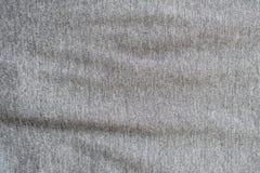 Закройте вверх по серой текстуре ткани Справочная информация Стоковые Фотографии RF