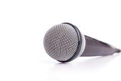 Закройте вверх по старому микрофону изолированному на белизне стоковые фото