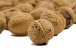 Грецкие орехи на белой предпосылке Стоковые Изображения RF