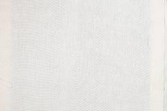 Закройте вверх по текстуре белого материала ткани Стоковое Изображение RF