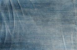 Закройте вверх по текстуре голубых демикотона или джинсовой ткани Стоковые Изображения