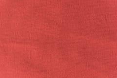 Закройте вверх по текстуре красных/пинка ткани Справочная информация Стоковое фото RF