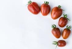 Закройте вверх по томату вишни на белой изолированной предпосылке Стоковые Фото